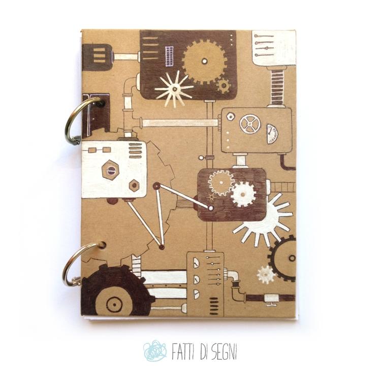 notes con copertina in cartone rivestito di carta da pacchi disegnata con pennarelli e penne a sfera.