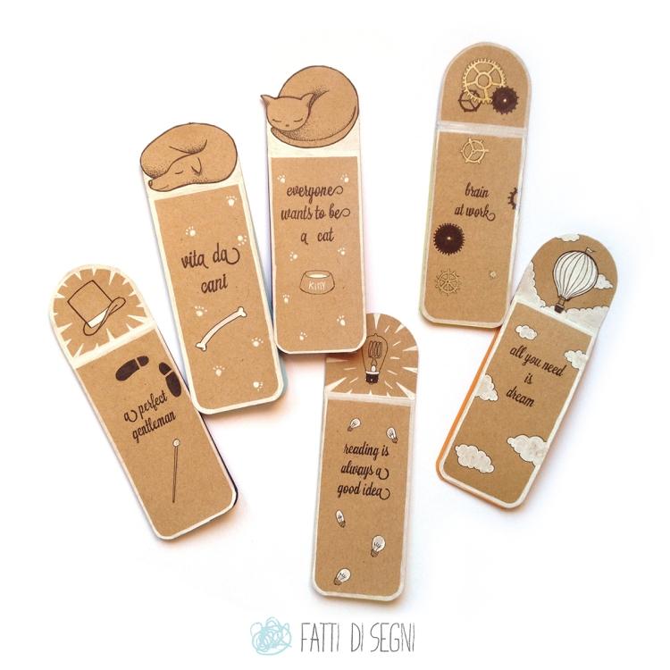 segnalibri in carta da pacchi in vari soggetti decorati con penne a sfera e pennarelli.