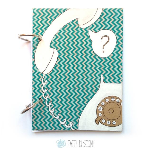notes con copertina in cartone rivestito di carta da pacchi disegnata con pennarelli e penne a sfera e decorata con washitape.